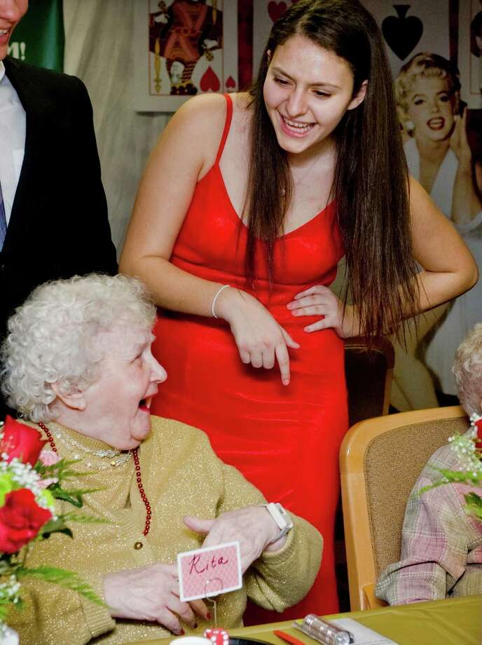 "Danbury High School Peer Leadership Group senior Ritta Hanna jokes with Rita Monahan, a resident at The Gardens Senior Care Center in Danbury. The Peer Leadership Group hosted ìA Night in Vegasî, a ""Senior Senior Prom"" at the Center. Some 25 residents attended the event. Saturday, Feb. 1, 2014 Photo: Scott Mullin / The News-Times Freelance"