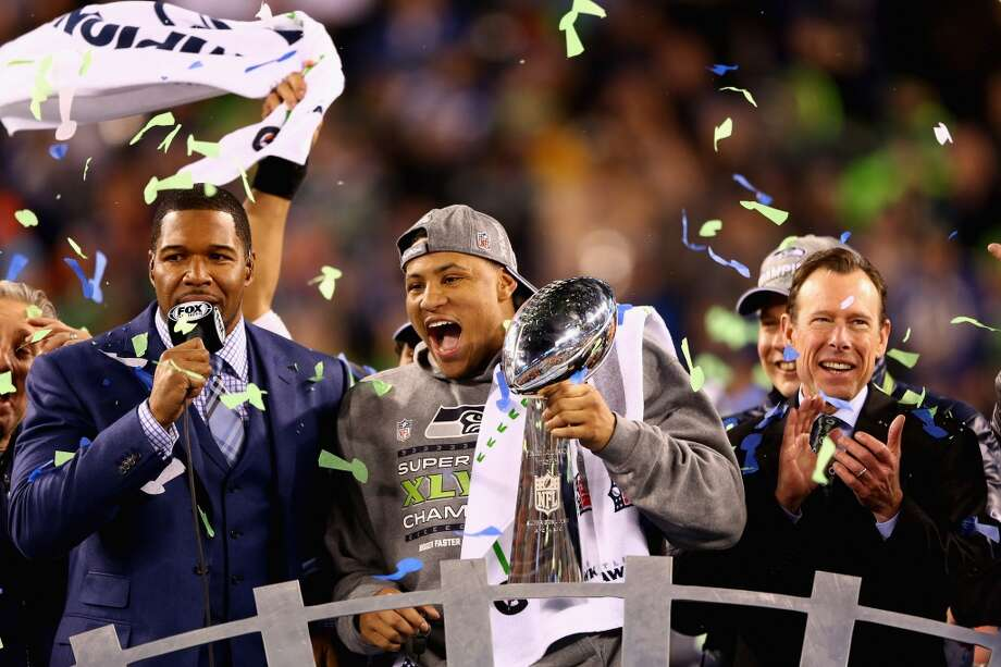 Outside linebacker and Super Bowl MVP Malcolm Smith #53 of the Seattle Seahawks holds the Vince Lombardi Trophy after winning Super Bowl XLVIII at MetLife Stadium on February 2, 2014 in East Rutherford, New Jersey.The Seahawks beat the Broncos 43-8.   (Photo by Elsa/Getty Images) Photo: Elsa, Getty Images