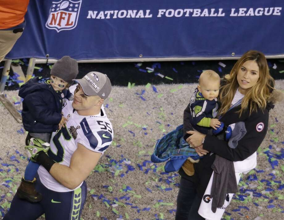 Seattle Seahawks' Heath Farwell walks on the field with his family after the NFL Super Bowl XLVIII football game against the Denver Broncos Sunday, Feb. 2, 2014, in East Rutherford, N.J. The Seahawks won 43-8. (AP Photo/Mel Evans) Photo: Mel Evans, Associated Press