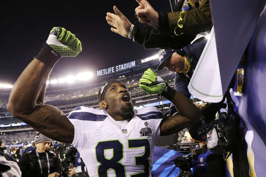 Seattle Seahawks' Ricardo Lockette celebrates with fans after the NFL Super Bowl XLVIII football game against the Denver Broncos Sunday, Feb. 2, 2014, in East Rutherford, N.J. The Seahawks won 43-8. (AP Photo/Mark Humphrey) Photo: Mark Humphrey, Associated Press