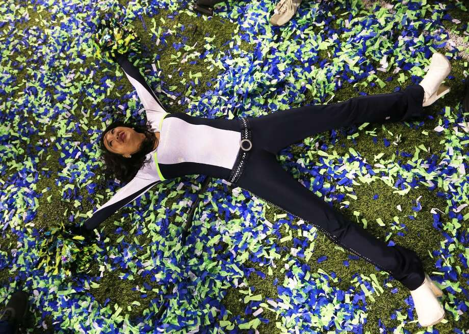 A Seattle Seahawks cheerleader celebrates after Super Bowl XLVIII at MetLife Stadium on February 2, 2014 in East Rutherford, New Jersey. The Seahawks beat the Broncos 43-8.  (Photo by Jamie Squire/Getty Images) Photo: Jamie Squire, Getty Images