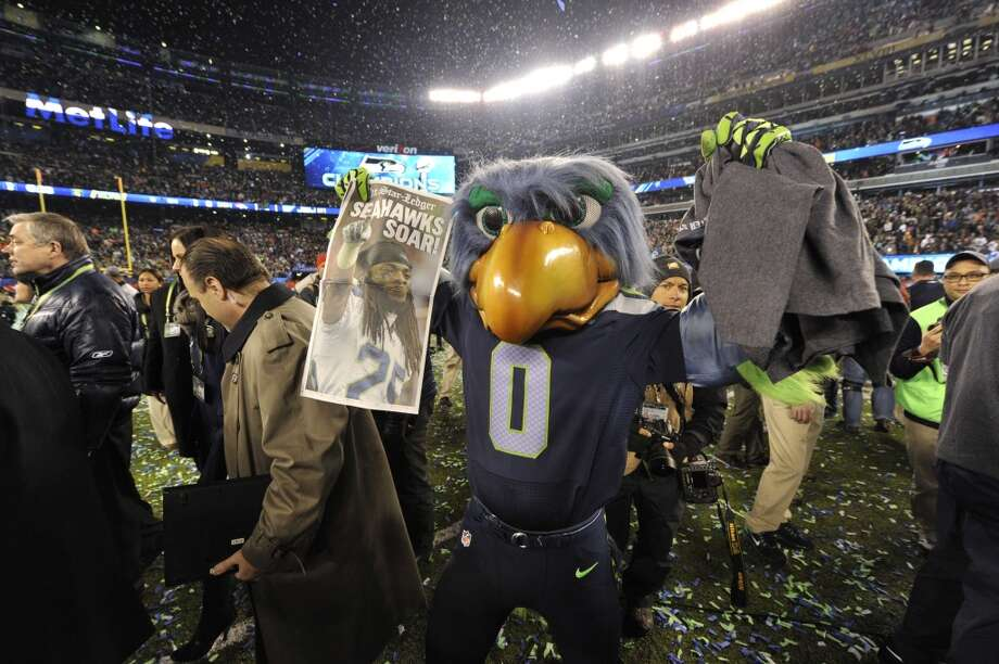 Seattle Seahawks mascot Taima the Hawk celebrates after they defeated the Denver Broncos 43-8 in Super Bowl 48 at MetLife stadium in East Rutherford, New Jersey, on February 2, 2014.    AFP PHOTO /  Timothy CLARYTIMOTHY A. CLARY/AFP/Getty Images Photo: TIMOTHY A. CLARY, AFP/Getty Images