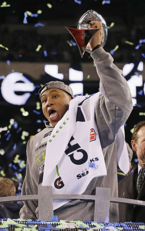 MVP Malcolm Smith #53 of the Seattle Seahawks celebrates with the Vince Lombardi Trophy after their 43-8 victory over the Denver Broncos during Super Bowl XLVIII at MetLife Stadium on February 2, 2014 in East Rutherford, New Jersey.  (Photo by Kevin C. Cox/Getty Images) Photo: Kevin C. Cox, Getty Images