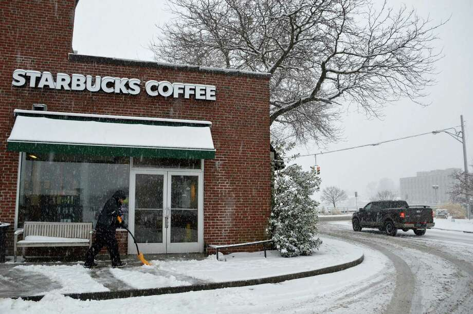 Clearing a path for the caffeinated crowd headed Monday morning to the downtown Starbucks. Photo: Jarret Liotta / Westport News
