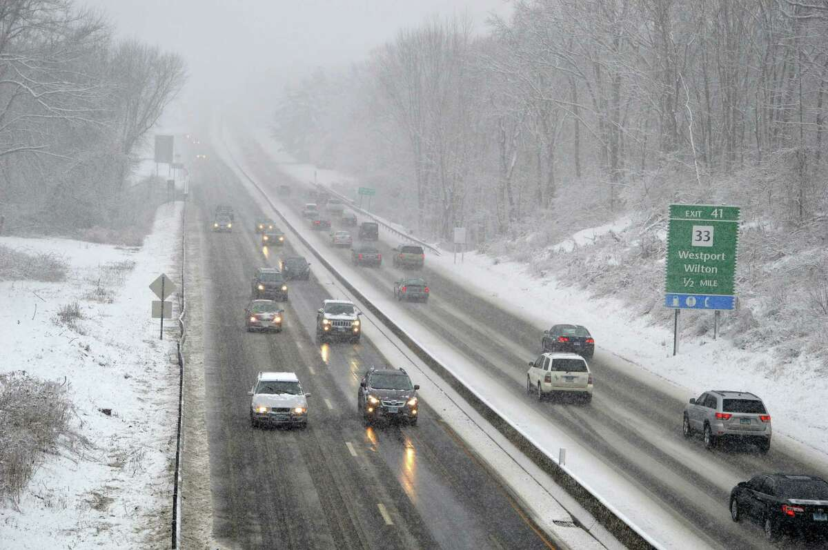 Monday's early snowfall slowed the morning commute, but traffic was moving steadily along the Merritt Parkway in Westport.