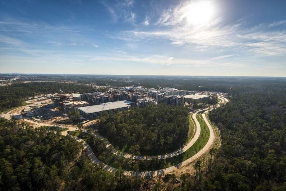 The new Exxon Mobil corporate campus under construction near The Woodlands is seen on Thursday, May 23, 2013.  The new development is near Interstate 45 and the Hardy Toll Road. In total, the complex will house 10,000 people when it opens in 2015. ( Smiley N. Pool / Houston Chronicle ) Photo: Smiley N. Pool, Houston Chronicle
