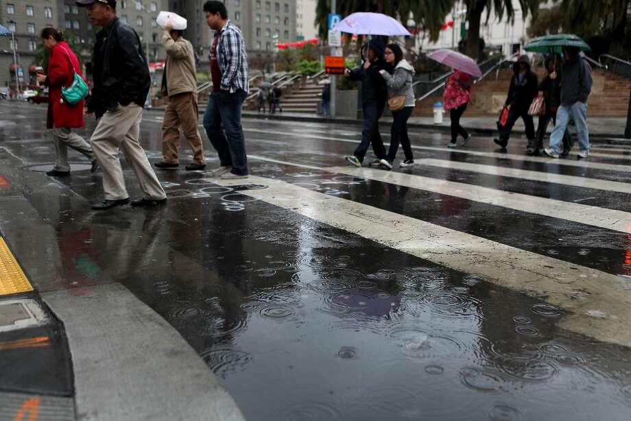 The rain doesn't stop people from shopping around Union Square, San Francisco Calif. on Feb. 2, 2014. Photo: Deborah Svoboda, The Chronicle