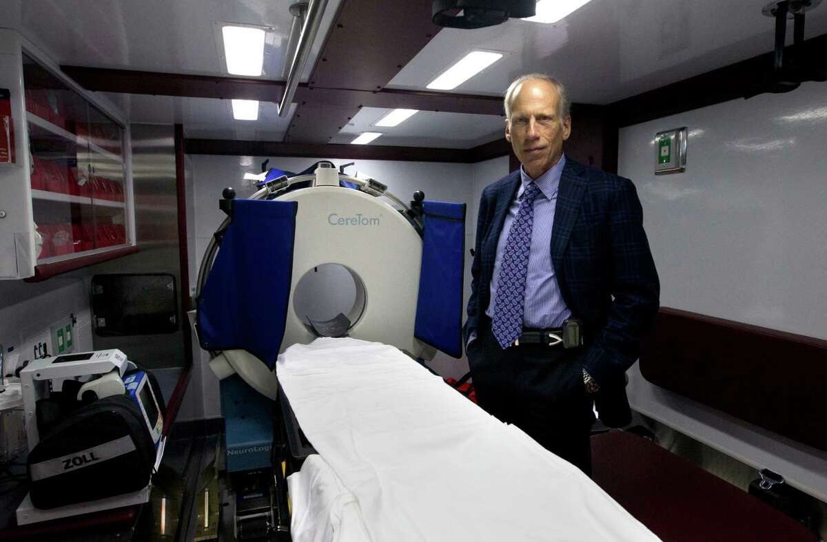 M.D., director of stroke research in the Center for Innovation & Research at Memorial Hermann-TMC, James C. Grotta stands inside the nation's first Mobile Stroke Unit at the University Of Texas Health And Science, Monday, Feb. 3, 2014, in Houston. On board the ambulance is a computed tomography (CT) scanner that allows a mobile stroke unit team member to quickly assess whether a patient is having a stroke caused by a blood clot and if so, the clot-buster tPA (tissue plasminogen activator) can be administered. The stroke unit will be run in conjunction with the Emergency Medical Services of the Houston Fire Department, Bellaire Fire Department and West University Fire Department.