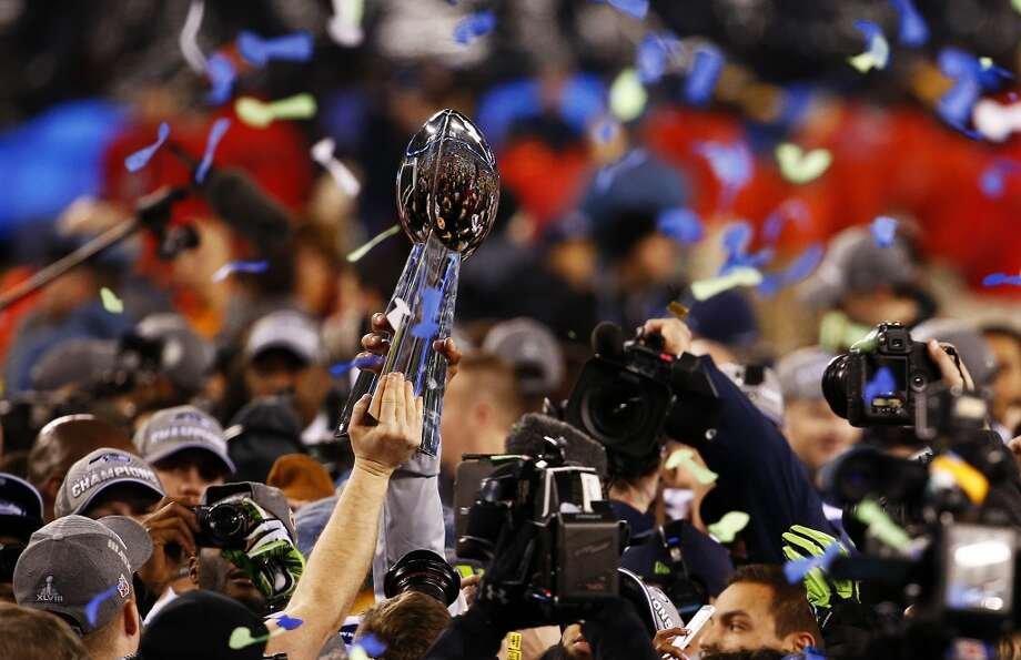 Seattle Seahawks players holds up Super Bowl Trophy after winning Super Bowl XLVIII at MetLife Stadium on February 2, 2014 in East Rutherford, New Jersey. The Seahawks beat the Broncos 43-8.  (Photo by Tom Pennington/Getty Images) Photo: Tom Pennington, Getty Images