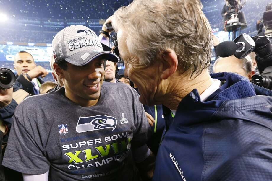 Seattle Seahawks head coach Pete Carroll, right, celebrates with quarterback Russell Wilson after the NFL Super Bowl XLVIII football game Sunday, Feb. 2, 2014, in East Rutherford, N.J. The Seahawks won 43-8. (AP Photo/Paul Sancya) Photo: Paul Sancya, Associated Press
