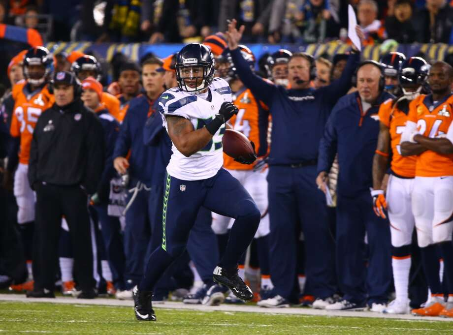 Seattle's Malcolm Smith returns an interception for a touchdown during  Super Bowl XLVIII Sunday, Feb. 2, 2014, at MetLife Stadium in New Jersey. (Joshua Trujillo, seattlepi.com) Photo: JOSHUA TRUJILLO, SEATTLEPI.COM