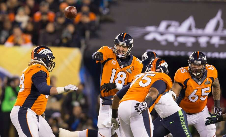Denver's Peyton Manning throws a pass during Super Bowl XLVIII Sunday, Feb. 2, 2014, at MetLife Stadium in New Jersey. (Jordan Stead, seattlepi.com) Photo: JORDAN STEAD, SEATTLEPI.COM