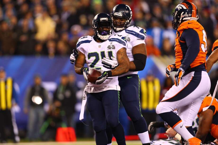 Seattle's Marshawn Lynch celebrates with Michael Bennet after scoring a touchdown during Super Bowl XLVIII Sunday, Feb. 2, 2014, at MetLife Stadium in New Jersey. (Jordan Stead, seattlepi.com) Photo: JORDAN STEAD, SEATTLEPI.COM
