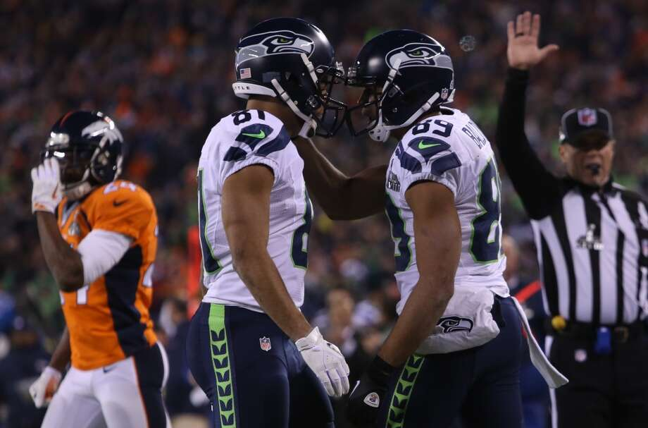 Seattle's Golden Tate, left, and Doug Baldwin, right, talk after a play at Super Bowl XLVIII Sunday, Feb. 2, 2014, at MetLife Stadium in New Jersey. (Joshua Trujillo, seattlepi.com) Photo: JOSHUA TRUJILLO, SEATTLEPI.COM