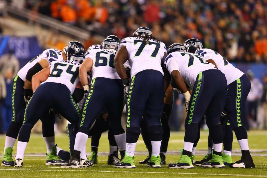 The Seattle Seahawks in a huddle at Super Bowl XLVIII Sunday, Feb. 2, 2014, at MetLife Stadium in New Jersey. (Jordan Stead, seattlepi.com) Photo: JORDAN STEAD, SEATTLEPI.COM