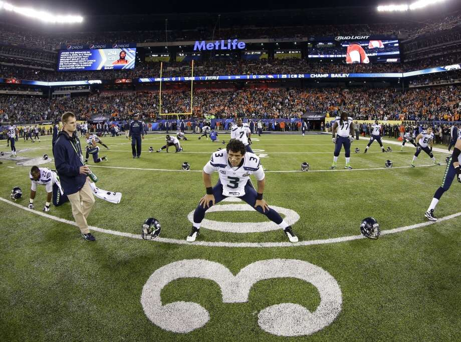 Seattle Seahawks quarterback Russell Wilson (3) warms up with teammates before the NFL Super Bowl XLVIII football game against the Denver Broncos Sunday, Feb. 2, 2014, in East Rutherford, N.J. (AP Photo/Matt Slocum) Photo: Matt Slocum, Associated Press