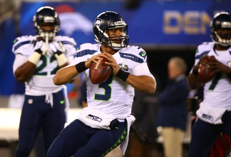Seattle Seahawks quarterback Russell Wilson looks for a receiver at MetLife Stadium for at Super Bowl XLVIII Sunday, Feb. 2, 2014, in New Jersey. (Joshua Trujillo, seattlepi.com) Photo: JOSHUA TRUJILLO, SEATTLEPI.COM