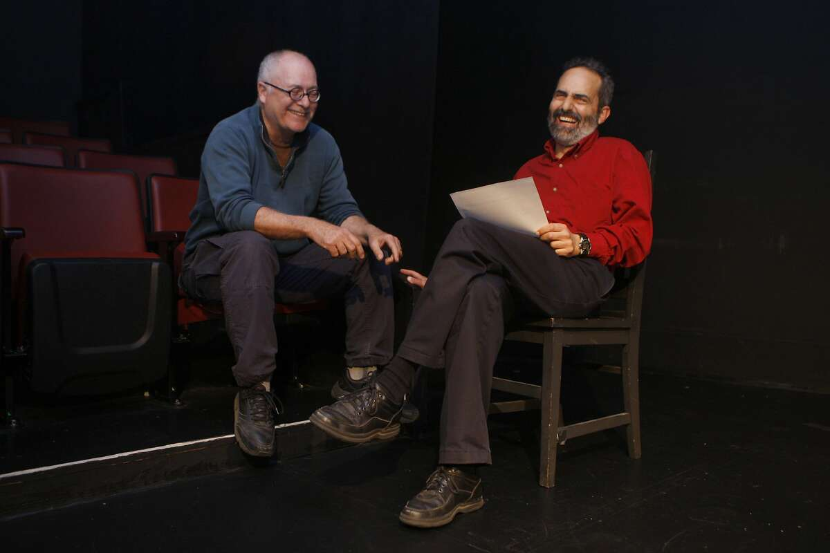 Director David Ford (back left) talks with actor Charlie Varon (right) during a rehearsal at the Marsh in San Francisco, Calif., on Tuesday, January 28, 2014.