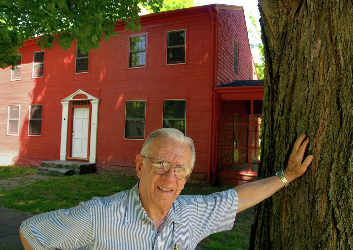 Milford City Historian Richard Platt poses at the historic Downs home in 2007.