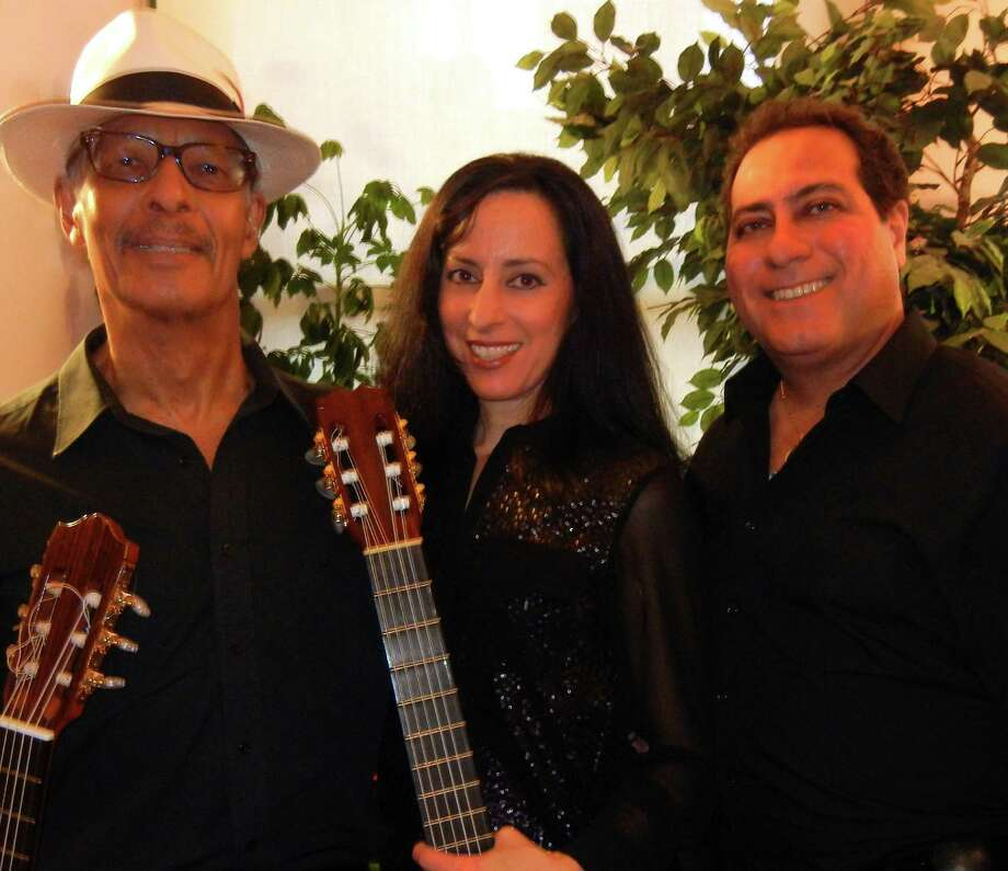 "Guitarist Josué Pérez, left, Lisa Spraragen, and tenor Angel Feliciano make up the trio Cantando así (Singing Like This). The three will present ""The Romance of the Spanish Guitar"" on Saturday, Feb. 22, at the Vista on the Hill Concert Series at Temple Beth Elohim in Brewster, N.Y. Not only does Spraragen play the guitar, she's also a flamenco dancer. Photo: Contributed Photo / The News-Times Contributed"