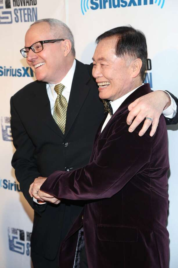 "Brad Takei (L) and George Takei attend SiriusXM's ""Howard Stern Birthday Bash"" at Hammerstein Ballroom on January 31, 2014 in New York City. Photo: Rob Kim, Getty Images"