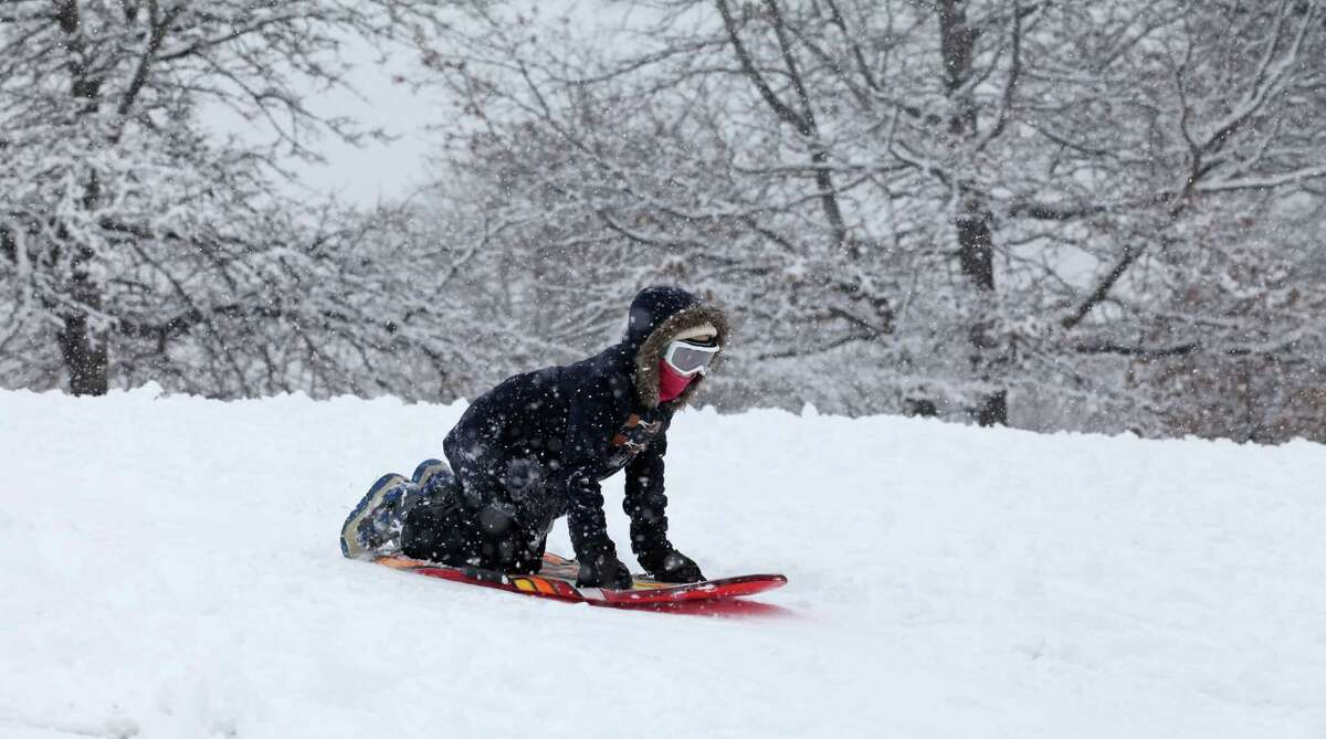 Jane Iwanicki, 11, sleds at Jonathan Law High School in Milford, Conn. on Monday, Feb. 3, 2014.