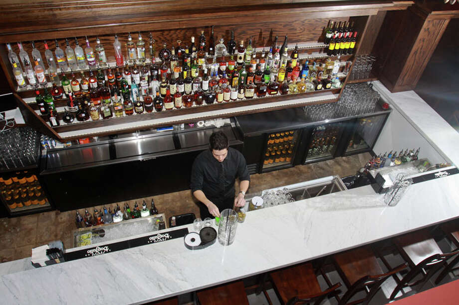 Bartender Mike Gonzalez at Marfreless, the River Oaks bar that has reopened after extensive renovations. It celebrated its 40th anniversary just months before closing in February of 2013. Photo: Gary Fountain, For The Houston Chronicle / Copyright 2014 Gary Fountain.