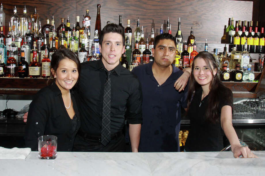 Bartenders Robin Sinclair, from left, Mike Gonzalez, Antonio Santiago and Jaclyn Hill at Marfreless, the River Oaks bar which has reopened after extensive renovations. It celebrated its 40th anniversary just months before closing in February of 2013. Photo: Gary Fountain, For The Houston Chronicle / Copyright 2014 Gary Fountain.