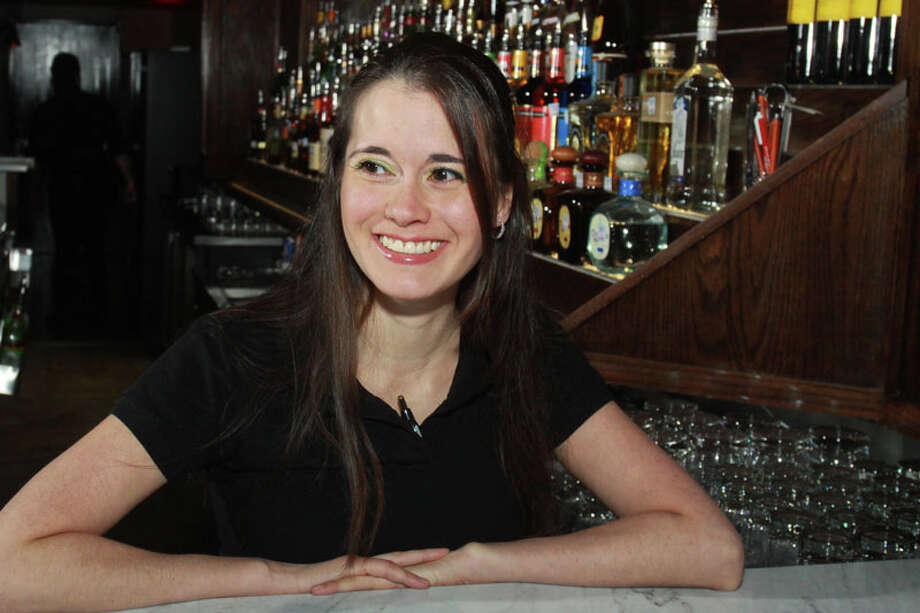 Bartender Jaclyn Hill at Marfreless, the River Oaks bar which has reopened after extensive renovations. It celebrated its 40th anniversary just months before closing in February of 2013. Photo: Gary Fountain, For The Houston Chronicle / Copyright 2014 Gary Fountain.