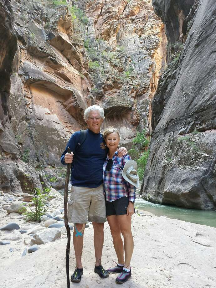 "Ed and Gwen Kinney, of Windsor, visited Zion National Park in Utah in September 2013. They are seen here in the Virgin River ""Narrows"" canyon river walk. Photo: Ed And Gwen Kinney"