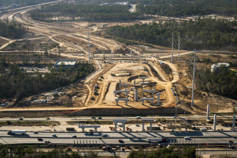 May 2013: Construction on the interchange of the Grand Parkway and I-45 just south of the new Exxon Mobil corporate campus under construction near The Woodlands on Thursday, May 23, 2013. The new development is near Interstate 45 and the Hardy Toll Road. In total, the complex will house 10,000 people when it opens in 2015. Photo: Smiley N. Pool, Houston Chronicle