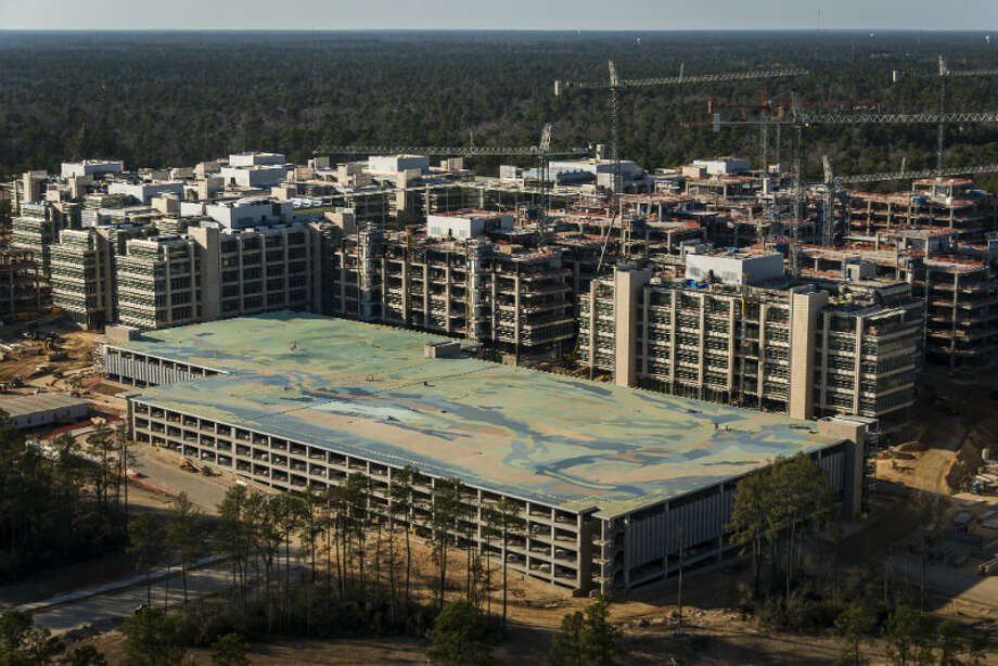 May 2013: The new Exxon Mobil corporate campus under construction near The Woodlands is seen on Thursday, May 23, 2013. The new development is near Interstate 45 and the Hardy Toll Road. In total, the complex will house 10,000 people when it opens in 2015. Photo: Smiley N. Pool, Houston Chronicle