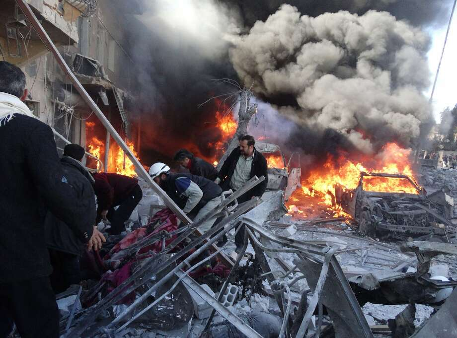 Barrel bombs batter city:Medical personnel search for survivors following government airstrikes on the Tariq al-Bab district of Aleppo,   Syria. At least 121 people were killed in the weekend bombardments, according to a human rights group. Photo: Mohammed Al-khatieb, AFP/Getty Images