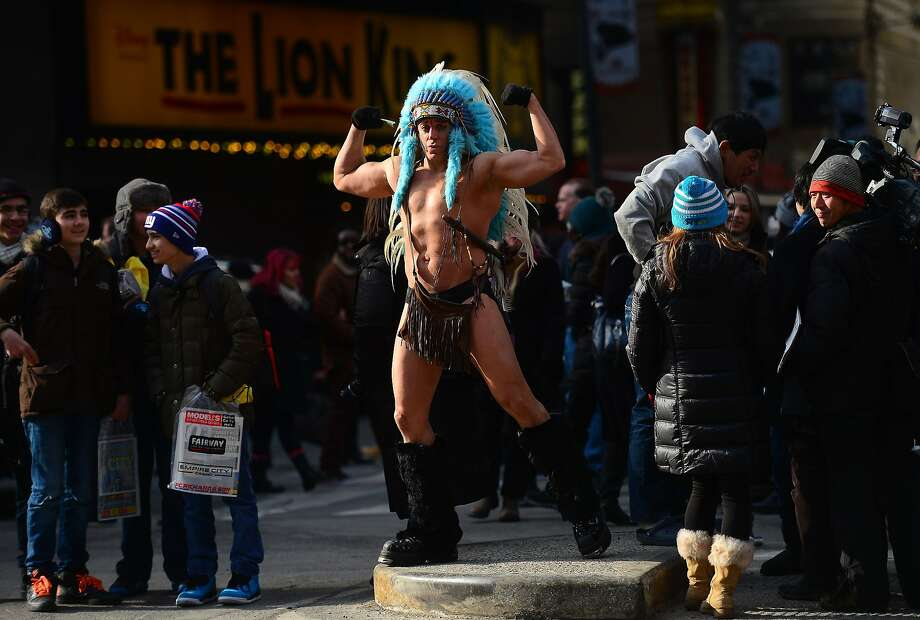 """Now all they need is a Naked Construction Worker, Naked Policeman, Naked Soldier and Naked Leatherman:The Naked   Cowboy, a fixture in New York's Times Square, apparently has competition. An underdressed man calling himself the   """"Naked Indian"""" performed in freezing temperatures for passers-by. Photo: Emmanuel Dunand, AFP/Getty Images"""
