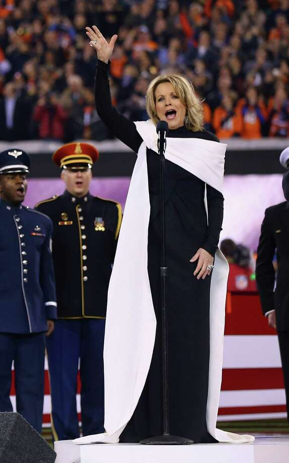 EAST RUTHERFORD, NJ - FEBRUARY 02:  Opera singer Renée Fleming signs the national anthem during Super Bowl XLVIII at MetLife Stadium between the Denver Broncos and the Seattle Seahawks on February 2, 2014 in East Rutherford, New Jersey. Photo: Elsa, Getty Images / 2014 Getty Images