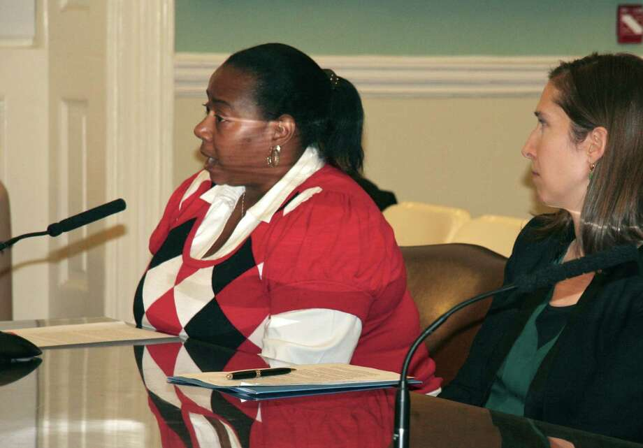 In this Dec. 12, 2013 photo provided by A Better Balance, caregiver Dena Adams, left, accompanied by attorney Phoebe Taubman, testifies before the New York City Council Civil Rights Committee. If you don't get a job because you're a woman, or you get fired because you're black, or you get put on a bad shift because you're gay, there's a law for that. But if you're punished at work because you need time to talk to your kid's teacher on the phone or take your elderly mother to the doctor, you might be out of luck. In most places around the country, advocates say, there's no explicit protection against employment discrimination based on a worker's status as a caregiver. A pending bill in New York City aims to plug that hole. (AP Photo/A Better Balance) ORG XMIT: MER2014020300110950 / A Better Balance