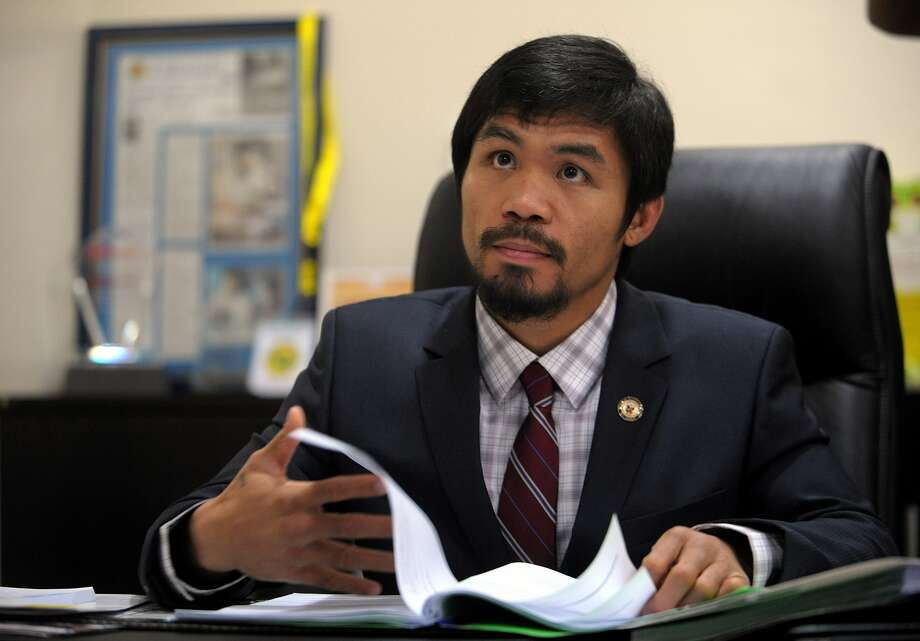 While Pacquiao hasn't officially retired, he turned his boxing popularity into votes in his home country, getting elected to the House of Representatives in the 15th Congress of the Philippines.  Photo: Noel Celis