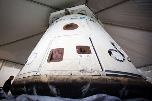 SpaceX shows off its Dragon capsule, the first private spacecraft to orbit and return safely to Earth, at its facilities near Cape Canaveral, Fla., in July 2011. (Smiley N. Pool / Houston Chronicle) Photo: Smiley N. Pool, Houston Chronicle