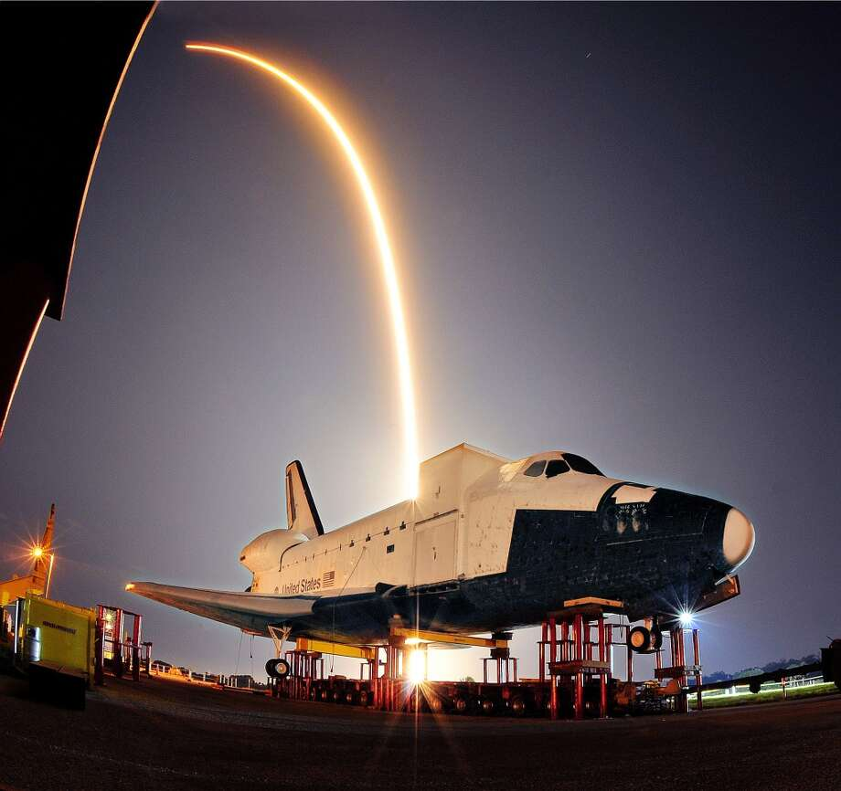 The SpaceX launch of its Falcon 9 rocket and a unmanned Dragon capsule lights up the sky over Cape Canaveral on May 22, 2012. (Craig Rubadoux / Florida Today, Associated Press) Photo: Craig Rubadoux, Associated Press