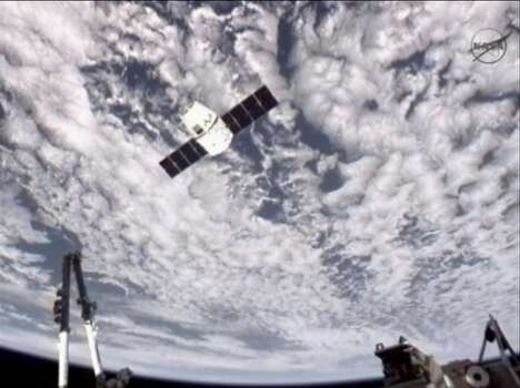 NASA-TV shows the Dragon commercial cargo craft approaching the International Space Station on May 25, 2012. (NASA / Associated Press) Photo: Associated Press