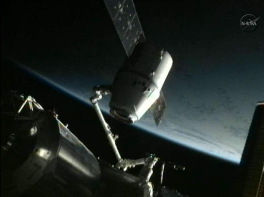 The Dragon capsule backs away from the International Space Station and gets repositioned for release later May 31, 2012. (NASA / Associated Press) Photo: Uncredited, Associated Press