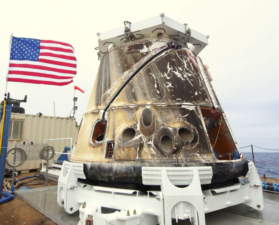 Dragon is recovered after splashdown May 31, 2012, in the Pacific Ocean. The capsule then was taken by barge to the Port of Los Angeles, arriving on June 5. (SpaceX / Associated Press) Photo: Associated Press