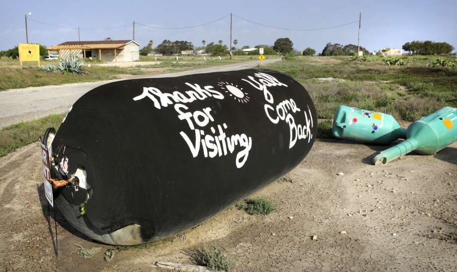 An improvised sign marks the entrance to Boca Chica Village, May 2, 2013, with homes occupied primarily by winter Texans.  The neighborhood is approximately 1.5 miles from the proposed launch site near Brownsville. (Bob Owen / San Antonio Express-News) Photo: Bob Owen, San Antonio Express-News