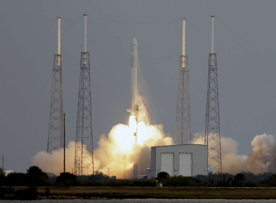 The Falcon 9 SpaceX rocket lifts off from launch complex 40 at the Cape Canaveral Air Force Station in Cape Canaveral, Fla., Friday, March 1, 2013. The rocket is transporting the Dragon capsule to the International Space Station containing more than a ton of food, tools, computer hardware and science experiments. (AP Photo/John Raoux) Photo: John Raoux, Associated Press