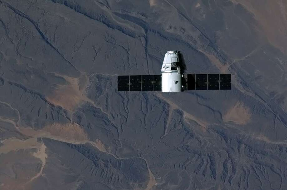 This NASA image on Twitter by ISS Flight Engineer Chris Hadfield, the SpaceX Dragon cargo vehicle soars over sub-Saharan Africa during the approach to the International Space Station on March 1, 2013. The privately-owned unmanned US space capsule owned by SpaceX arrived at the International Space Station on March 3, bringing to the space outpost food, scientific materials and other crucial equipment. The capsule named Dragon was captured -- with the help of a robotic arm - by NASA Expedition 34 Commander Kevin Ford and Flight Engineer Tom Marshburn, 5:31 am EST (1031 GMT), when the ISS was over northern Ukraine, US space officials said.   (NASA / Chris Hadfield) Photo: CHRIS HADFIELD, AFP/Getty Images