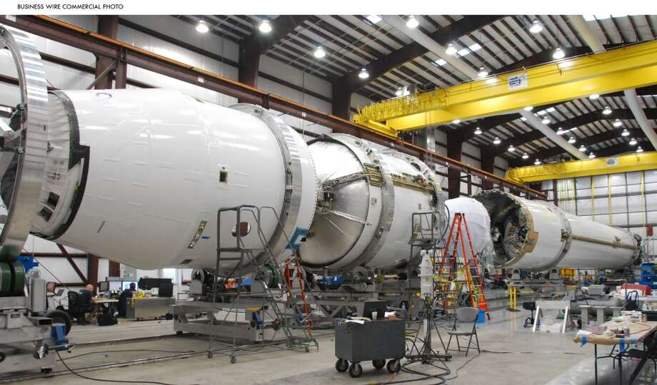 Flight hardware for the inaugural launch of Falcon 9 rocket undergoes final integration in the hangar at Cape Canaveral. (SpaceX) Photo: Business Wire