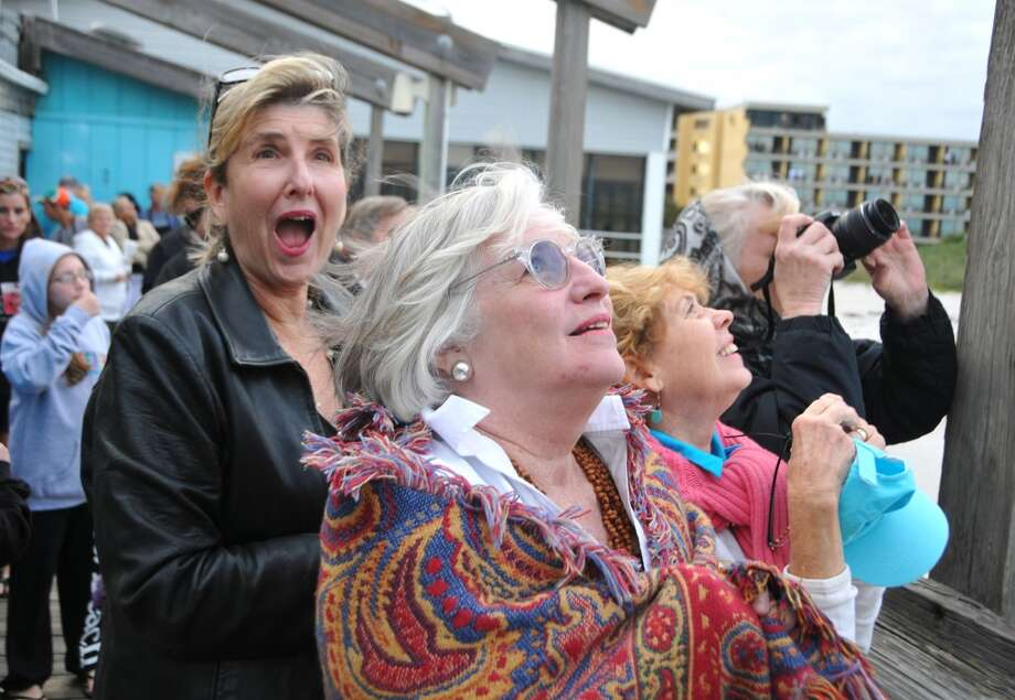 Suzanne Peters, Mary Ann Sigler, Gail Heebner and Holi Hassinger get excited as they watch the SpaceX Falcon 9 launch Jan. 6, 2014, carrying a Thiacom 6 communications satellite into orbit.   (Malcolm Denemark / Florida Today, Associated Press) Photo: Malcolm Denemark, Associated Press