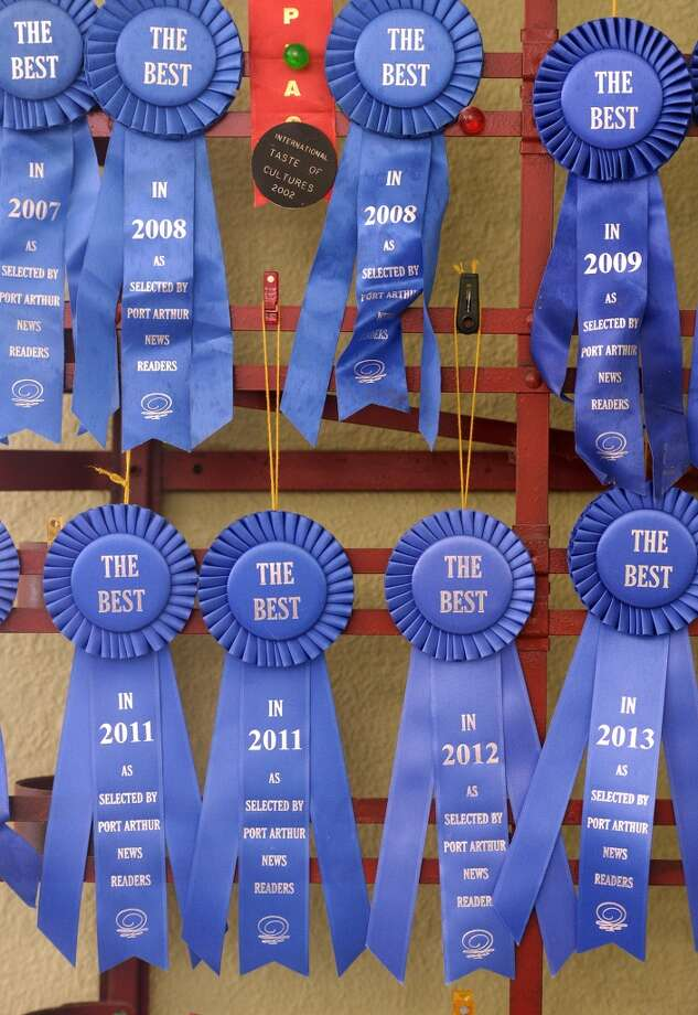 Awards and ribbons hang in a corner of Daviss Donuts and Deli on Tuesday morning. The Nederland bakery is the CAT5 Restaurant of the Week for January 30, 2014. Photo taken Tuesday, 1/21/14 Jake Daniels/@JakeD_in_SETX