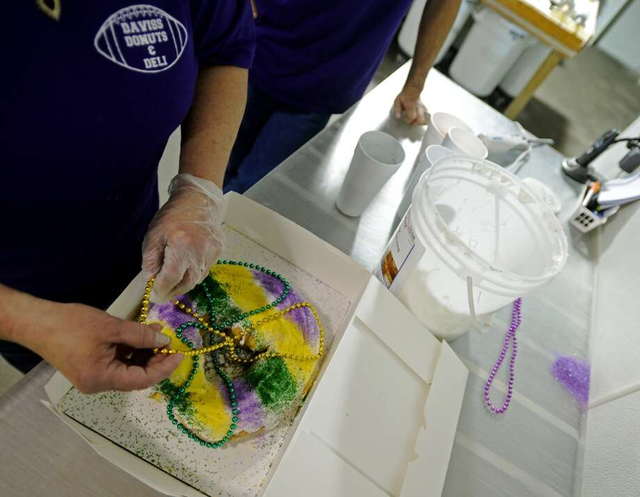 Renee Skinner prepares an apple cinnamon king cake in the kitchen of Daviss Donuts and Deli in Nederland on Tuesday. The bakery is the CAT5 Restaurant of the Week for January 30, 2014. Photo taken Tuesday, 1/21/14 Jake Daniels/@JakeD_in_SETX