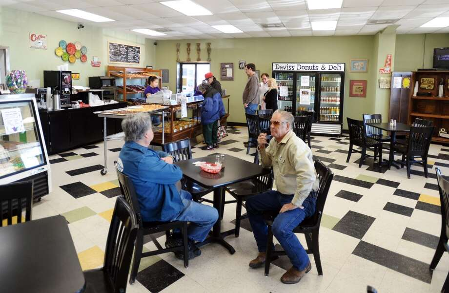 John Mazzara, left, and CC Johnnie sit at a table at Daviss Donuts and Deli in Nederland on Tuesday morning. The bakery is the CAT5 Restaurant of the Week for January 30, 2014. Photo taken Tuesday, 1/21/14 Jake Daniels/@JakeD_in_SETX